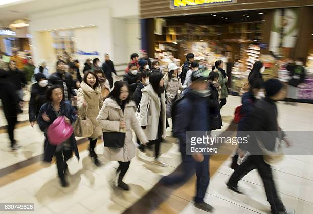 Shoppers enter the Aeon Lake Town shopping mall operated by Aeon Retail Co a unit of Aeon Co on the first day of the New Year sales in Koshigaya...