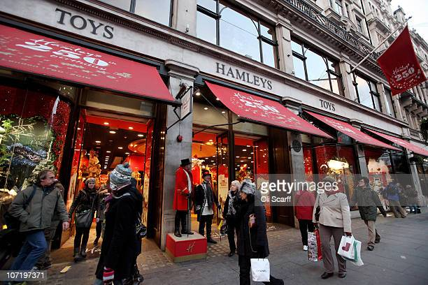 Shoppers enter the Hamleys toy store adorned with its Christmas window display on November 29 2010 in London England Despite the global economic...