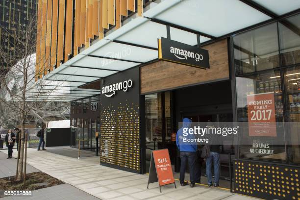 Shoppers enter the new Amazoncom Inc Go grocery store in Seattle Washington US on Wednesday March 8 2017 Amazon's goal is to become a Top 5 grocery...