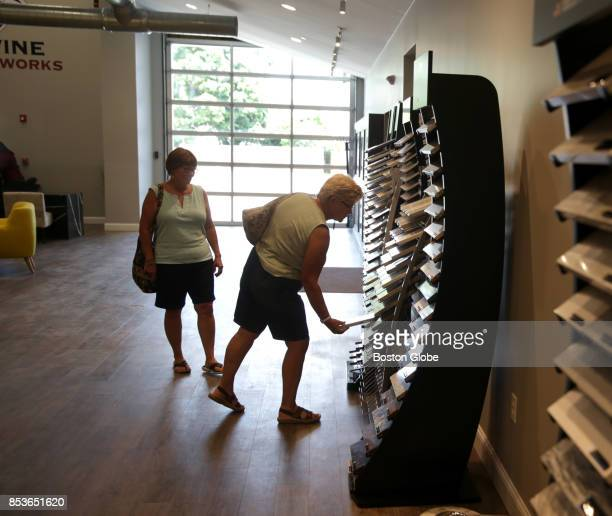 Shoppers examine products at Divine Stoneworks inside the Metro West Design Center in Ashland MA on Aug 1 2017 For years Ashland has been trying to...