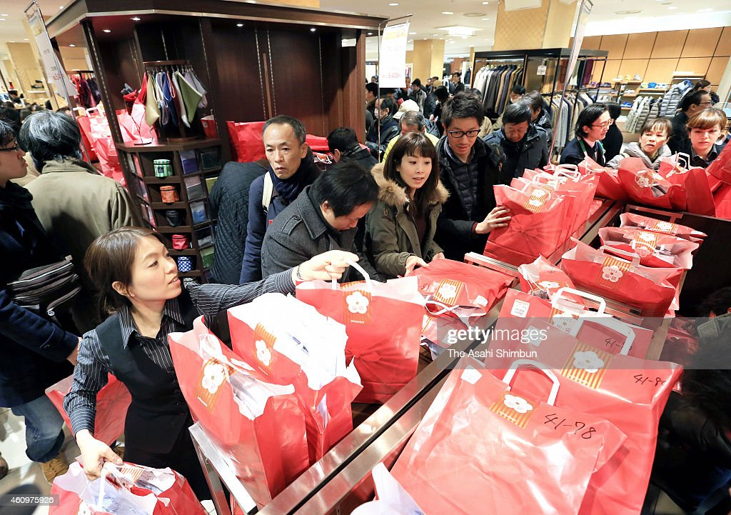 Shoppers Rush To 'Lucky Bags' As New Year Sale Begins : News Photo