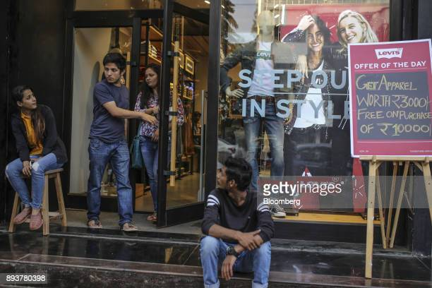 Shoppers exit a Levi Strauss Co store in Mumbai India on Friday Dec 15 2017 India's inflation surged past the central bank's target bolstering a view...