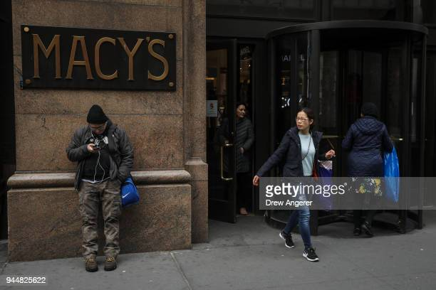 Shoppers exit a Macy's store in the Herald Square neighborhood of Manhattan April 11 2018 in New York City US consumer prices rose 24 percent in...