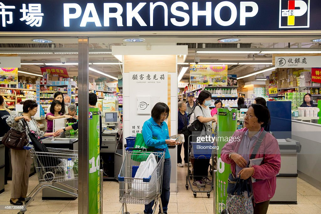 Shoppers exit a ParknShop supermarket, operated by Hutchison Whampoa Ltd., at Lok Fu Plaza, operated by the Link Real Estate Investment Trust (REIT), in Hong Kong, China, on Monday, Nov. 10, 2014. The Link REIT, Asia's largest property trust which owns neighborhood malls, food markets, and car parks, is scheduled to announce interim results on Nov. 13. Photographer: Brent Lewin/Bloomberg via Getty Images