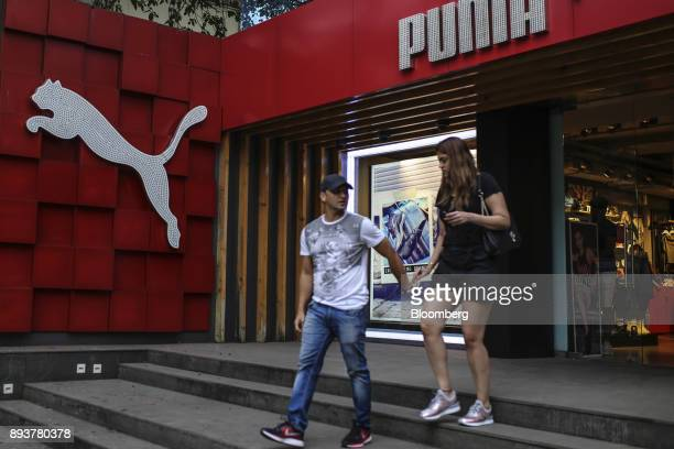 Shoppers exit a Puma SE store in Mumbai India on Friday Dec 15 2017 India's inflation surged past the central bank's target bolstering a view that...