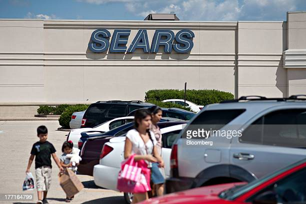 Shoppers exit a Sears store in Peoria Illinois US on Friday Aug 16 2013 Sears Holdings Corp is scheduled to release second quarter earnings on Aug 22...