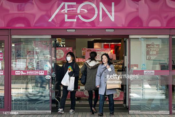 Shoppers exit an Aeon Co supermarket in Tokyo Japan on Thursday April 12 2012 Aeon Co Japan's largest supermarket operator reported consolidated...