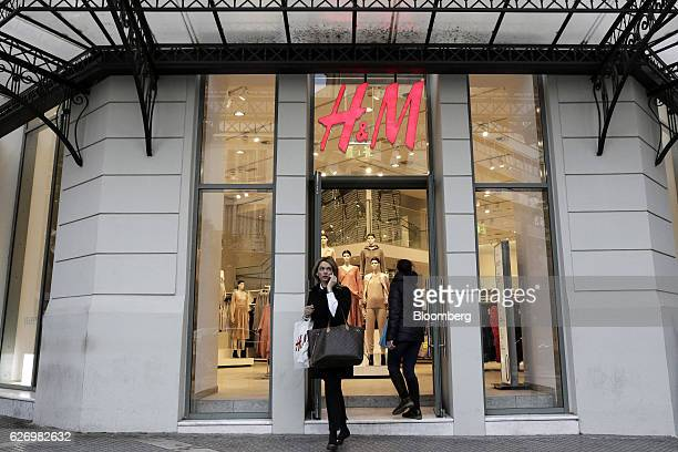 Shoppers exit and enter a Hennes Mauritz AB clothing store in Thessaloniki Greece on Thursday Dec 1 2016 Greek markets have rallied this month on...