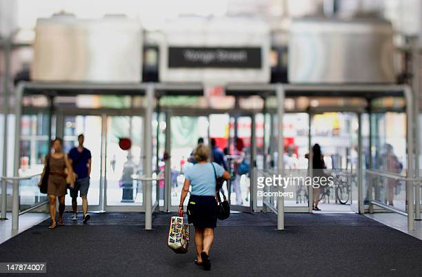 Shoppers exit Eaton Centre in this photo taken with a tilt shift lens in Toronto Ontario Canada on Wednesday July 4 2012 Canada's economy the world's...