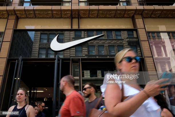 Shoppers exit Nike SoHo store June 15 2017 in New York City Nike announced plans on Thursday to cut about 2 percent of its global workforce