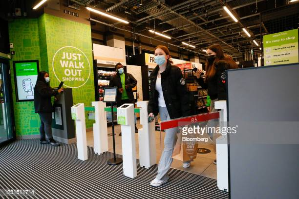 Shoppers exit the Amazon.com Inc. Amazon Fresh cashierless convenience store in the Ealing area of London, U.K., on Thursday, March 4, 2021. The...