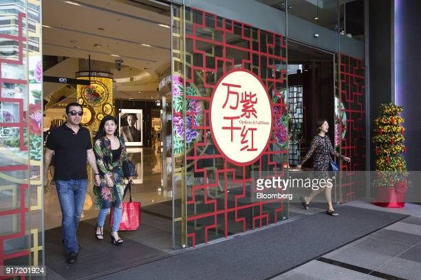 Shoppers exit the Ion Orchard mall jointly owned by CapitaLand Ltd and Sun Hung Kai Properties Ltd on Orchard Road in Singapore on Saturday Feb 10...
