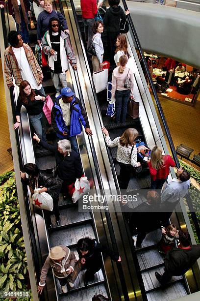 Shoppers fill an escalator inside the Lenox Mall Atlanta, Georgia, Friday, November 25, 2005.