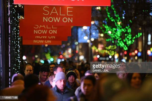 Shoppers fill the pavement on Oxford Street in central London on December 21 2019 on the last Saturday before Christmas