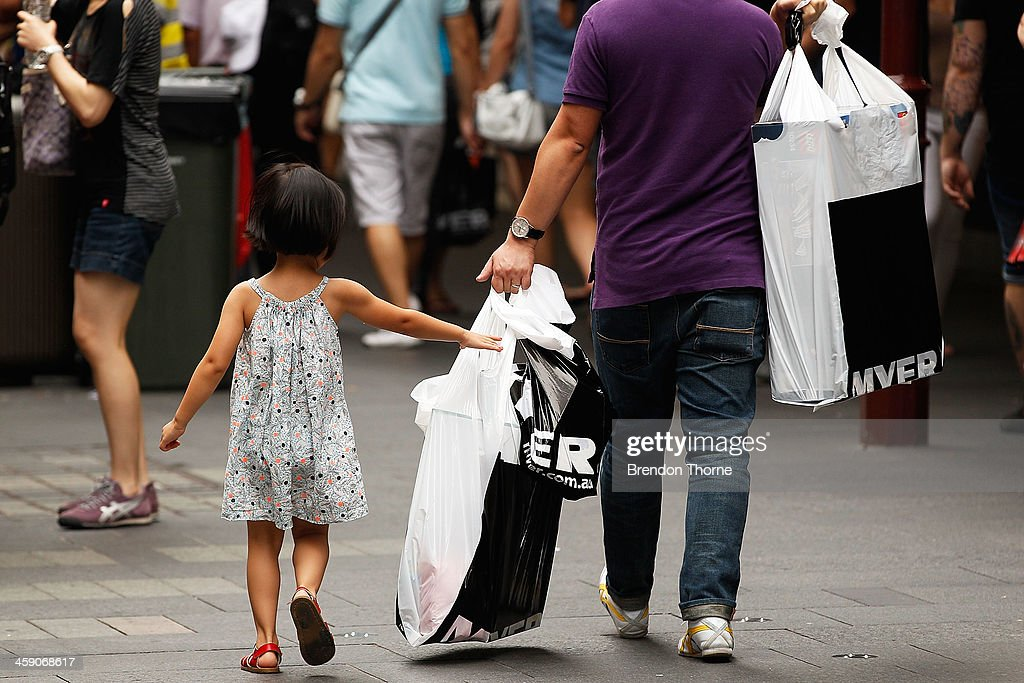 Shoppers flock to stores as retailers experience boost in sales on December 23, 2013 in Sydney, Australia. Australian retailers experience some of their busiest trades in the days leading up to Christmas with atleast $20 billion spent already.