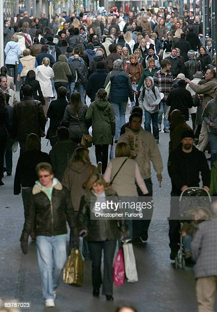 Shoppers flock to the city centre in search of bargains on November 22 2008 in Leeds England High street shops are aiming to attract Christmas trade...