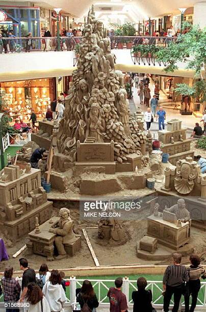 Shoppers gather around what its creators claim will be the world's largest indoor sand sculpture in a Thousand Oaks, California, shopping mall, 12...
