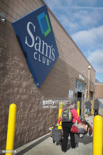 Shoppers head into a Sam's Club store on January 12 2018 in Streamwood Illinois The store is one of more 60 sheduled to close nationwide by the end...