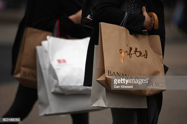 Shoppers hold packages on Regent Street during the Boxing Day sales on December 26 2015 in London England Boxing Day is one of the busiest days for...