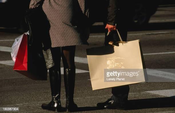 Shoppers holding designer shopping bags, Passeig de Gracia.
