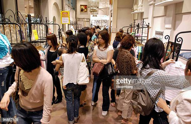 Shoppers in a Takashimaya department store in Nagoya shop for clothing Monday July 11 2005