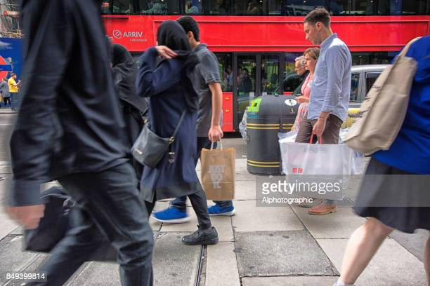 Shoppers in Central London legs