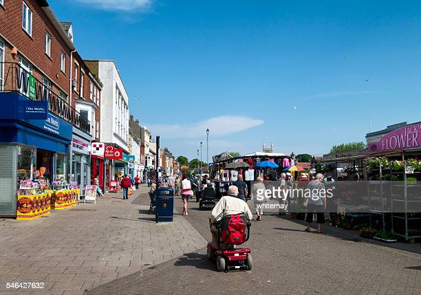 shoppers in great yarmouth market place - mobility scooter stock photos and pictures