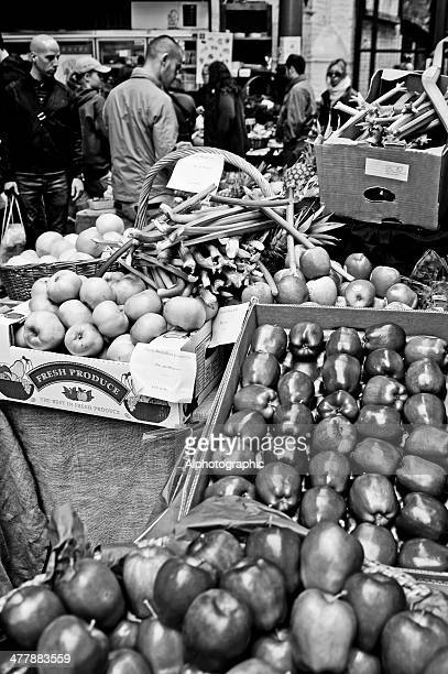 shoppers in london's borough market - black and white vegetables stock photos and pictures