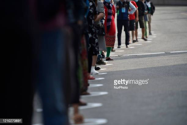 Shoppers in white circle obeyed 15meter social distancing while queuing to buy food during lockdown as concerns about the spread of Corona Virus in...