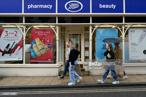Shoppers in York walk past a Boots pharmacy on July 09 2020 in York United Kingdom Many UK businesses are announcing job losses due to the effects of...