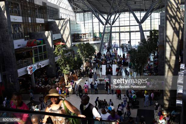Shoppers inside a mall on May 1 2013 at Maponya shopping Mall Soweto South Africa Maponya is one of several new shopping malls in the township Soweto...