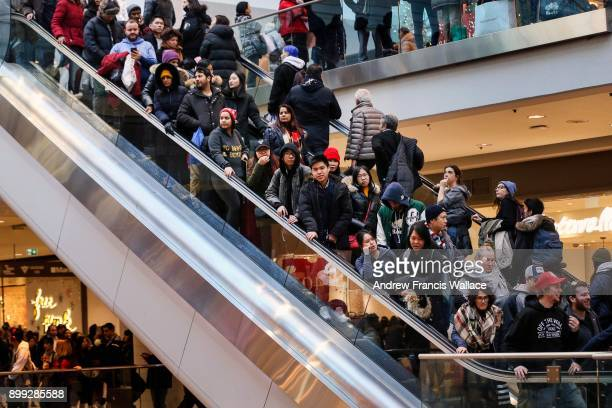 TORONTO ON DECEMBER 26 Shoppers jam the escalators looking for Boxing Day bargains at the Toronto Eaton Centre December 26 2017