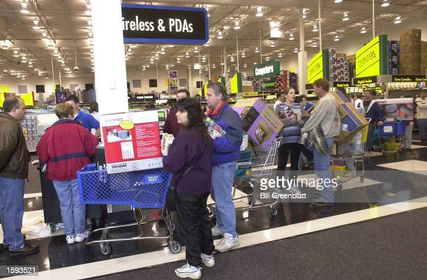 Shoppers kick off the holiday shopping season November 24 the busiest shopping day of the year known as Black Friday at a Best Buy store in Crestwood...