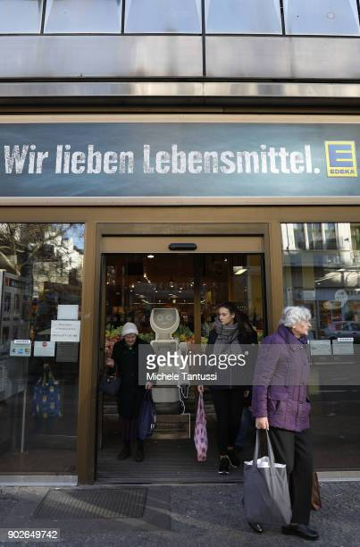 Shoppers leave a EDEKA Supermarket on January 8 2018 in Berlin Germany According to government statisticians nominal revenue grew compared to the...