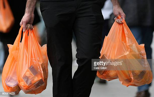 Shoppers leave a Sainsburys store with their purchases in plastic bags on February 29 2008 in London England The Prime Minister Gordon Brown has...