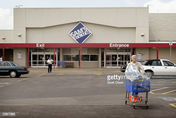 Shoppers leave a Sam's Club store August 13, 2003 in Des Plaines, Illinois. Wal-Mart Stores Inc., the parent company of Sam's Club, reported strong...