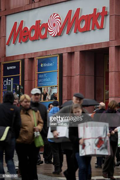 Shoppers leave a shopping mall that contains a store of German consumer electronics retail chain Media Markt on March 12 2010 in Berlin Germany Media...