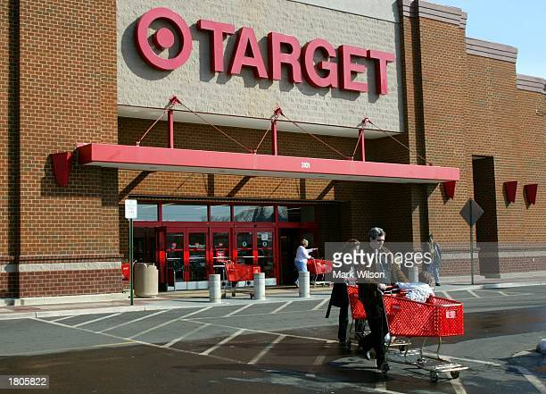 Shoppers leave a Target store February 20 2003 in Alexandria Virginia Target announced a modest four percent increase in profit for the fourth...