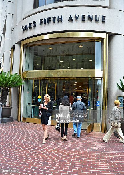 Shoppers leave and enter the Saks Fifth Avenue store in San Francisco's upscale Union Square shopping district