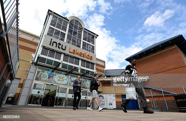Shoppers leave Lakeside shopping centre, operated by Intu Properties Plc., in Thurrock, U.K., on Wednesday, July 2015. U.K. Economic growth...