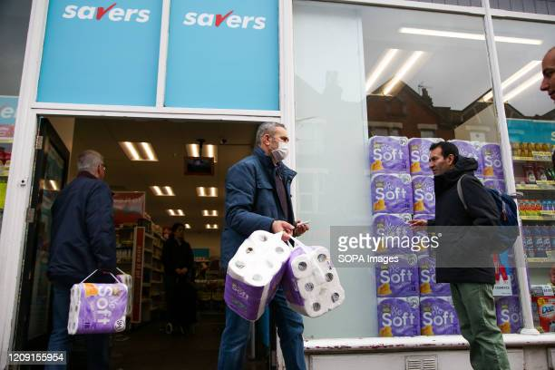 Shoppers leave Savers store with toilet rolls as fear of coronavirus outbreak in London