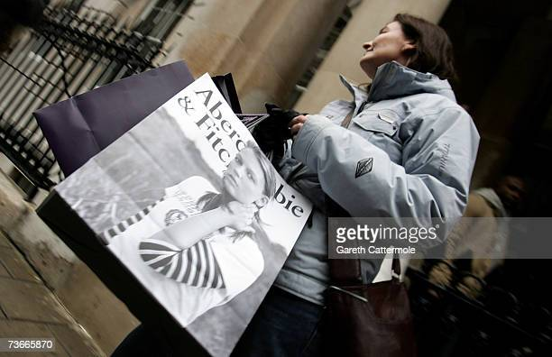 Shoppers leave the Abercrombie Fitch UK Flagship Store on Savile Row on March 22 2007 in London England The store opened its doors today and is the...