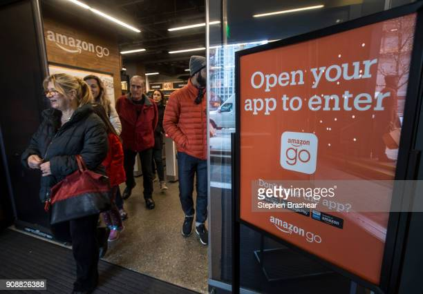 Shoppers leave the Amazon Go store after checking out on January 22 2018 in Seattle Washington After more than a year in beta the store is open to...