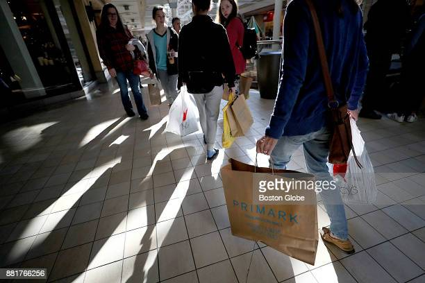 Shoppers leave the new Primark store at The Burlington Mall in Burlington MA on Black Friday Nov 24 2017
