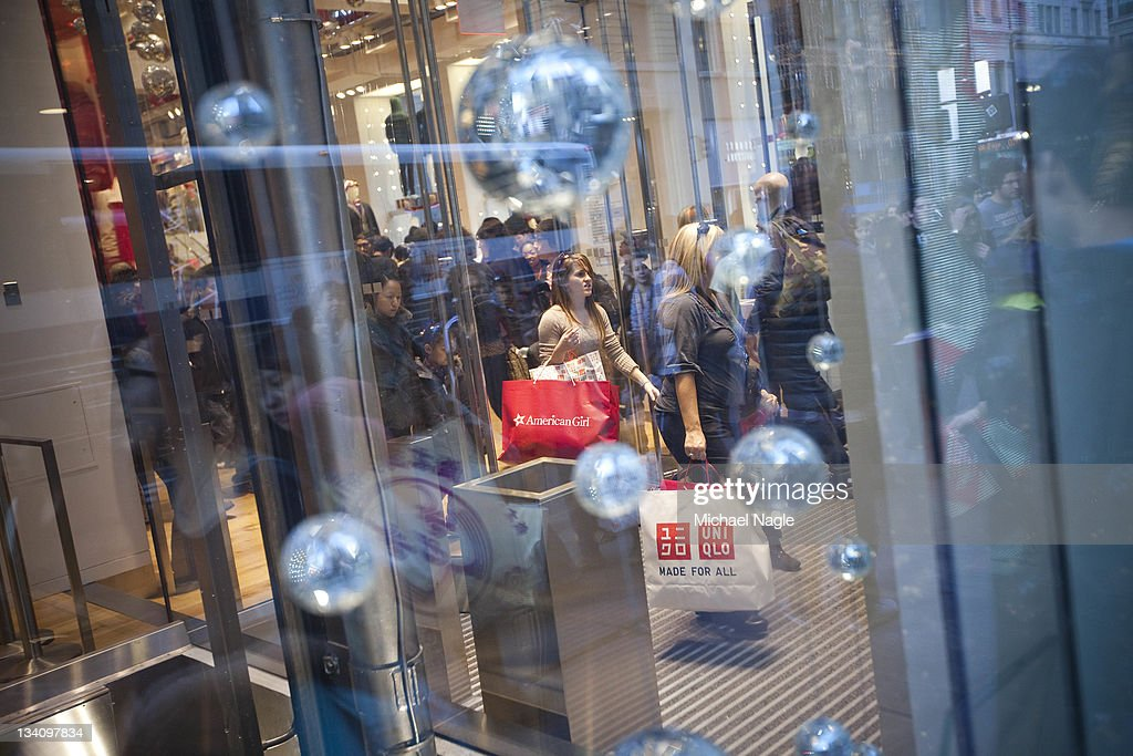 Shoppers leave Uniqlo on Fifth Avenue on 'Black Friday' on November 25, 2011, in New York City. Marking the start of the holiday shopping season, 'Black Friday' is one of American retailers' busiest days of the year.