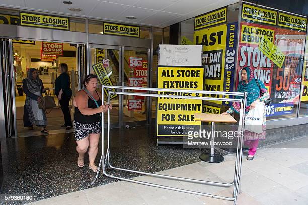 Shoppers leave with fixtures at the BHS store on Commercial Street on July 23 2016 in Newport Wales The store is one of 20 stores across the UK to...