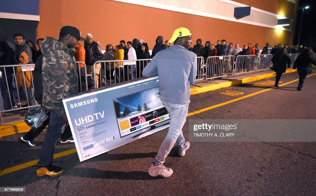 shoppers leave with television sets at best buy in norwalk connecticut november 232017 after waiting for hours in the cold for the store to open at 5pm - Best Buy Christmas Hours
