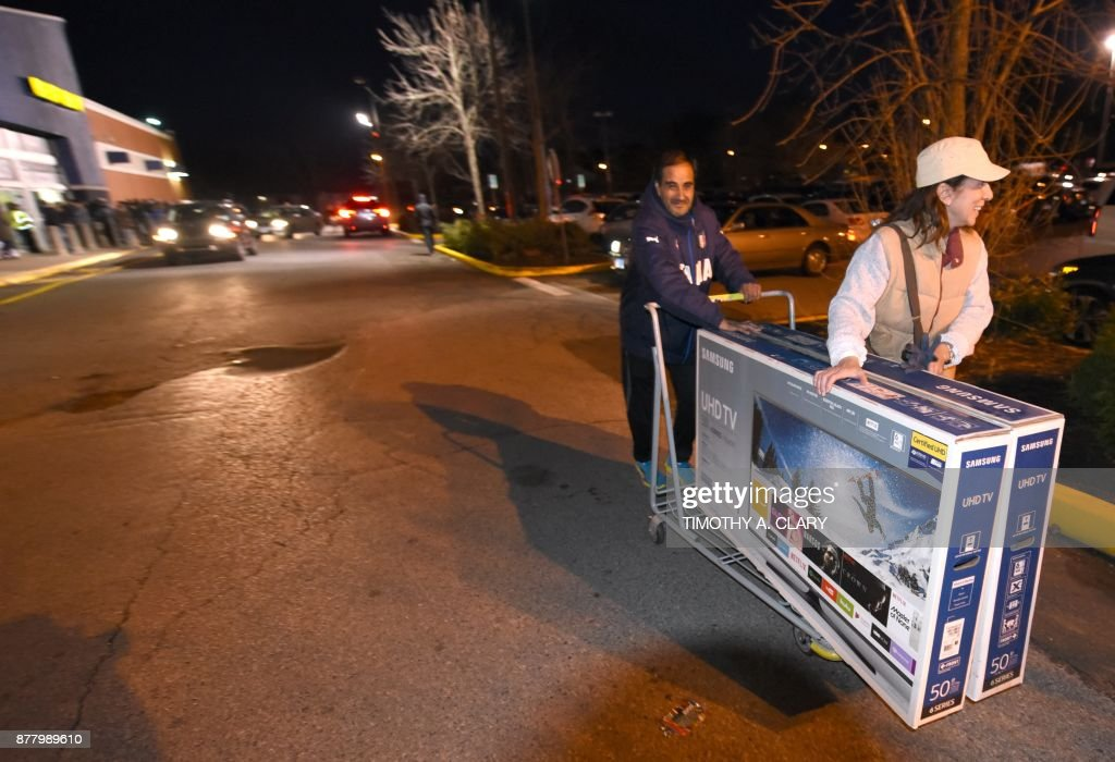 shoppers leave with television sets at best buy in norwalk connecticut november 232017 after waiting for hours in the cold for the store to open at 5pm - Best Buy Hours Christmas Day