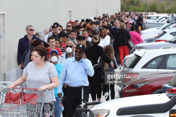 Shoppers line up around the building waiting to enter at Costco Perth on March 19 2020 in Perth Australia The store which is the first Costco in...