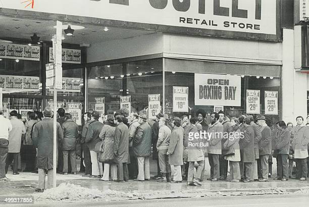 Shoppers line up on Yonge St yesterday waiting for stores to open with their Boxing Day sales Much of the business was in exchanges and refunds...